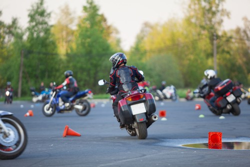 stock-photo-motorcyclists-ride-through-cones-exersice-for-beginners-and-experienced-free-skill-training-as-1119941606