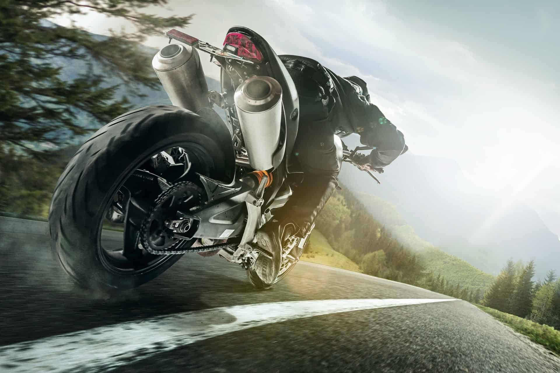 stock-photo-championship-of-motocross-side-view-of-sportsmen-driving-motorcycle-797080582-e1629780854153-min